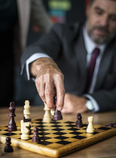 business men paying chess